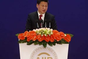 China's President Xi Jinping delivering a speech during the opening ceremony of the Asian Infrastructure Investment Bank.