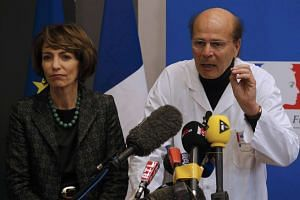 French Health Minister Marisol Touraine and Gilles Hedan, professor of clinical neurology, at a news conference.