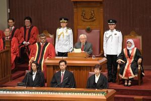 President Tony Tan Keng Yam opening the first session of the 13th Parliament, flanked by Chief Justice Sundaresh Menon and Speaker of Parliament Halimah Yacob.