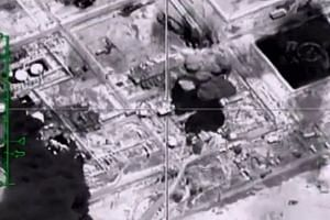 Screengrab from the Russian Defence Ministry purporting an explosion on Nov 23, 2015 controlled by IS fighters in Deir Ezzor, Syria.