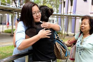 Ms Lee Li Lian (left), Workers' Party candidate for Punggol East, hugging a supporter.