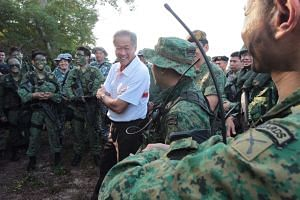 Defence Minister Ng Eng Hen visiting NSmen during a military exercise in Pulau Sudong.