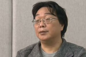 Screen grab taken from the CCTV footage in Beijing shows Gui Minhai speaking in an interview broadcast.