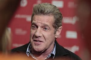 A file picture dated Jan 19, 2013, shows Glenn Frey talking to the press as he arrives for the premiere of the movie, History of The Eagles Part 1, at the 2013 Sundance Film Festival in Park City, Utah, USA.