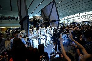 Star Wars fans coming face to face with Stormtroopers and the TIE fighter at Changi Airport last November. Over the years, US film company Disney has shifted its focus from cartoons featuring Mickey Mouse to blockbuster movies based on Marvel superhe