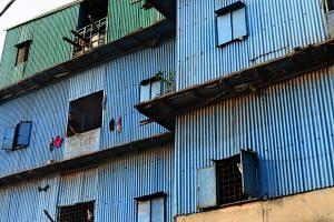 A Bangladeshi youth looks on from a slum house near the Buriganga river in Dhaka.