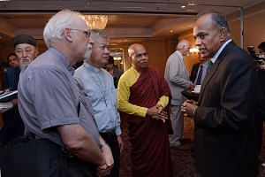 Home Affairs Minister K. Shanmugam (far right) chatting with (from second left) Reverend George Martzen, United Methodist Church missionary at Paya Lebar Chinese Methodist Church; Reverend Gabriel Liew, pastor of Kampong Kapor Methodist Church; and V