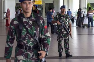 Indonesian soldiers stand guard at Ngurah Rai international airport in Bali, Indonesia.