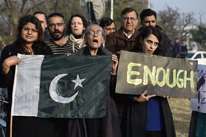 Activists gathering to condemn Taleban's attack at Bacha Khan University in Charsadda, Pakistan.