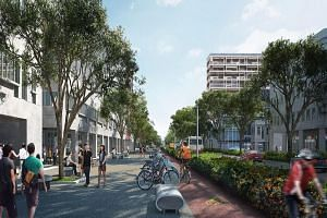 An artist's impression of Bencoolen Street, which will have a tree-lined footpath and a dedicated cycling lane on a 450m stretch between Middle Road and Bras Basah Road.