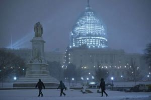 Pedestrians in front of the US Capitol in Washington, DC, on Jan 22, 2016.