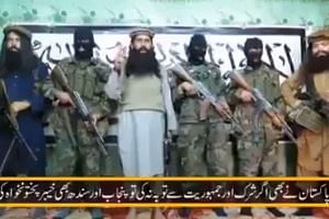 Taleban faction head Khalifa Umar Mansoor (centre) said in a video that schools would be targeted.
