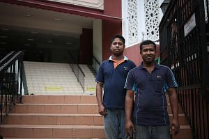 Bangladeshis Wazed Uddin (left) and Kajal Bepary at Assyakirin Mosque after Friday prayers last week. Mr Kajal, a Sunni who has worked in the manufacturing line here for seven years, says he is more comfortable practising his religion in Singapore, w