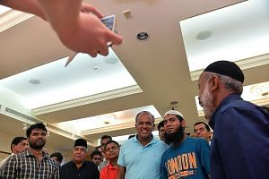"Mr Shanmugam (centre) at a thank-you lunch for several Bangladeshi construction workers at Khadijah Mosque yesterday. Addressing their worry about how the arrests of their countrymen would affect them, he said: ""I assured them, just stick to what you"
