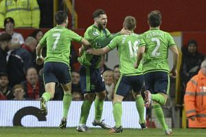 Charlie Austin (second from left) celebrates scoring the opening goal.