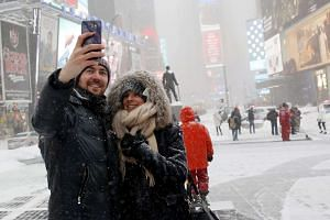 A couple take a selfie at Times Square in Manhattan, New York, on Jan 23, 2015.