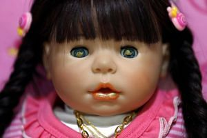 A Child Angels doll painted with holy gold sheets in its eyes and mouth.