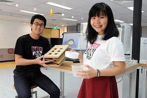 Gaines Goh and Winnie Lim at Ngee Ann Polytechnic's The Sandbox, an innovation and entrepreneurship office where students can brainstorm and test their projects. To help students develop their ideas, the polytechnic has supported about 250 student project