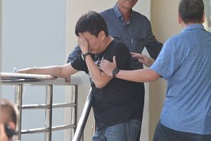 Madam Yep Lay Choo's husband, Mr Robin Poon (centre), was at the morgue on Monday morning with relatives to collect the victims' bodies.