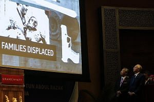Malaysian Prime Minister Najib Razak (right) and his deputy Ahmad Zahid Hamidi watching a video presentation during the International Conference on Deradicalisation and Countering Violent Extremismin Kuala Lumpur yesterday.