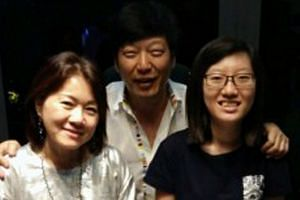 """Mr Poon, 50, with the two women he referred to as his """"princesses"""" - his wife, Madam Yep, 51, and daughter Kimberly, 22."""