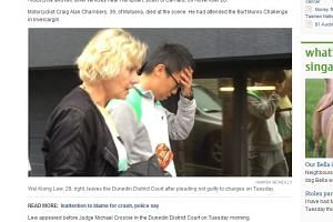 Singaporean Lew Wei Kiong (right) leaving the Dunedin District Court on Tuesday (Jan 26).