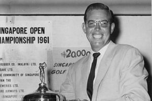 Australian golfer Frank Phillips holding the first Singapore Open trophy in 1961.