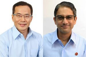 Dennis Tan (left) and Leon Perera got their first taste of verbal sparring in Parliament yesterday.