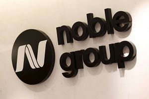 Noble Group has bought back part of two bonds, trimming its debt after the company was hit by a commodity market downturn and attacks on its accounting practices.