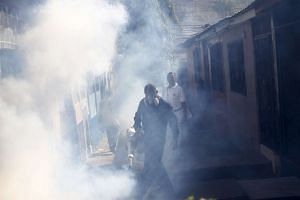 A municipal health worker fumigating a neighborhood as part of the city's effort to prevent the spread of the Zika virus, in Tegucigalpa, Honduras, on Jan 26, 2016.