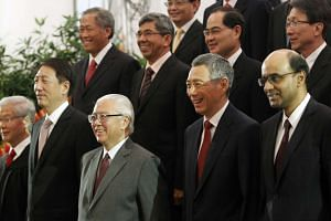 President Tony Tan Keng Yam (centre) and Prime Minister Lee Hsien Loong (second from right) in a group photo with cabinet ministers after the presidential swearing-in ceremony at the Istana on Sept 1, 2011.