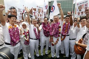 People's Action Party (PAP) candidates for Ang Mo Kio GRC (wearing garlands, from left) Mr Gan Thiam Poh, Dr Intan Azura Mokhtar, Mr Ang Hin Kee, Dr Koh Poh Koon, Prime Minister Lee Hsien Loong, and Mr Darryl David at the Raffles Institution nomina