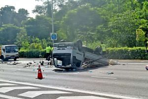 The lorry was flipped upside down by the impact of the crash. Both the driver and his passenger were sent to hospital.