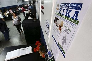 A poster with information about the Zika virus at the maternity ward of a hospital in Guatemala City on Jan 28.