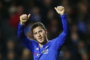 Eden Hazard celebrates scoring the fourth goal for Chelsea from the penalty spot on Sunday.