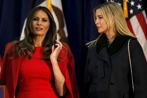 Donald Trump's wife, Melania Trump (left) and daughter Ivanka Trump, listening during his rally speech.