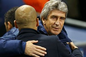 Manuel Pellegrini (right) embraces Pep Guardiola before a Champions League match in Manchester on Nov 25, 2014