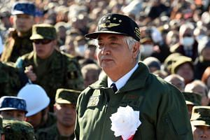 Japan's Defence Minister Gen Nakatani attends military exercises in Narashino on Jan 10, 2016.