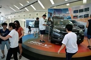 Car buyers at the Honda showroom at Leng Kee Road on Jan 10, 2016.