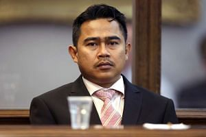 Former Malaysian diplomat Mohammed Rizalman Ismail sits in the dock as he pleads guilty in Wellington on Nov 30, 2015.