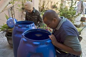 Officials looking for mosquito breeding spots in Sao Paulo, Brazil, on Feb 3.