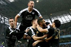 Leicester City's Robert Huth celebrates scoring against Manchester City.