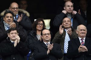 French President Francois Hollande (centre) watched the Six Nations match between France and Italy.