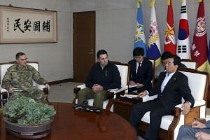 South Korean Defense Minister Han Min-koo (right) with US Forces Korea commander General Curtis Scaparrotti (left) and US Ambassador to South Korea Mark Lippert (centre) at the defense ministry in South Korea, on Feb 7, 2016.