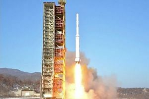 North Korea's locket launch of earth observation satellite Kwangmyong 4 in a picture taken from North Korean TV and released by South Korean news agency Yonhap on Feb 7, 2016.