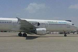 The damaged passenger plane taxis at the airport of Mogadishu, Somalia on Feb 2 this year.