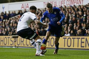 Leicester City's Jamie Vardy in action with Tottenham's Kyle Walker.