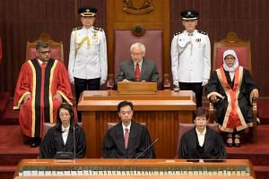 Singapore President Tony Tan Keng Yam (centre) opening the first session of the 13th Parliament, flanked by Chief Justice Sundaresh Menon (left) and Speaker of Parliament Halimah Yacob (right).