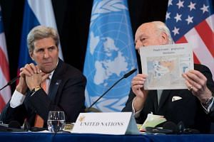 US Secretary of State John Kerry (left) and UN Special Envoy of the Secretary-General for Syria Staffan de Mistura hold a press conference after the ISSG meeting in Munich on Feb 11, 2016.