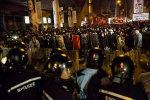 Rioters confront police in the Mong Kok area of Hong Kong on Feb 9, 2016.